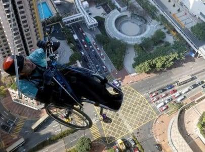 in wheelchair paraplegic lai chi wai climbs up skyscraper in hong kong