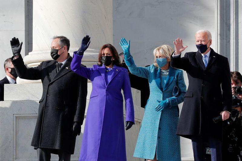 President-elect Joe Biden, his wife Jill Biden, Vice President-elect Kamala Harris and her husband Doug Emhoff salute as they arrive ahead of the inauguration of Biden, in Washington, US, January 20, 2021. PHOTO: REUTERS