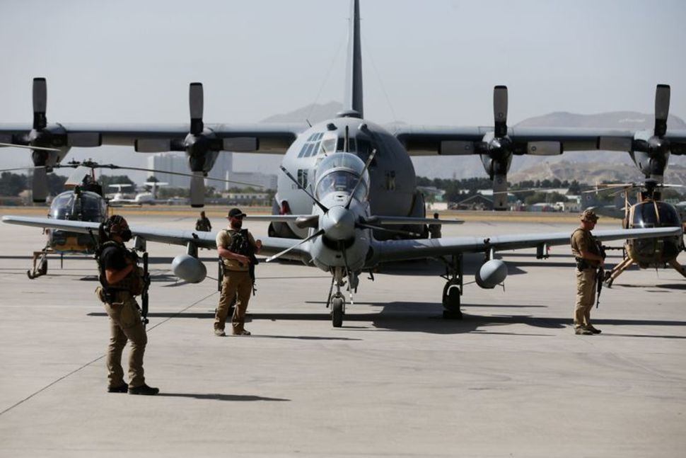 u s security personnel stand guard during a handover ceremony of a 29 super tucano planes from u s to the afghan forces in kabul afghanistan september 17 2020 reuters