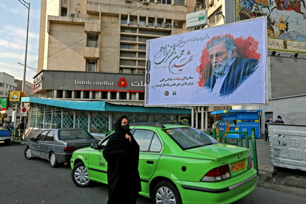 Fakhrizadeh, shown here on a billboard in the capital, did not have a high profile before he was killed, but is now being celebrated as a top