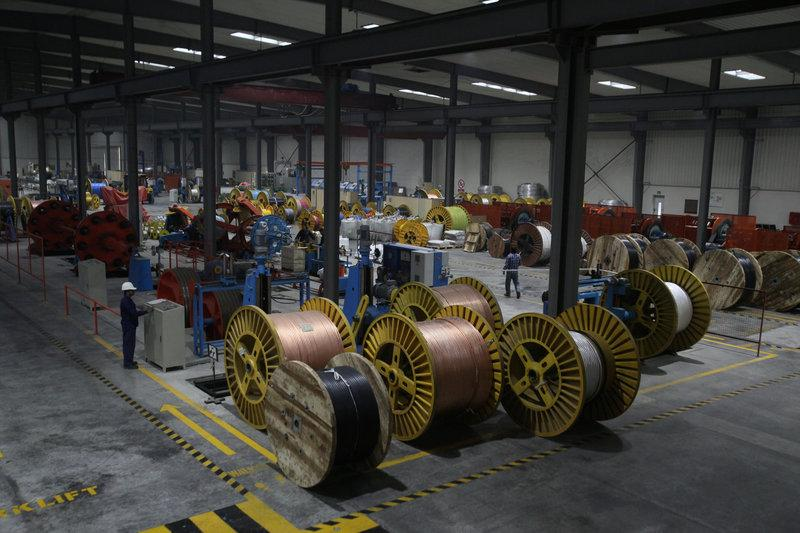 a worker monitors automatic copper wire unit at a plant in lahore pakistan march 24 2017 photo reuters file