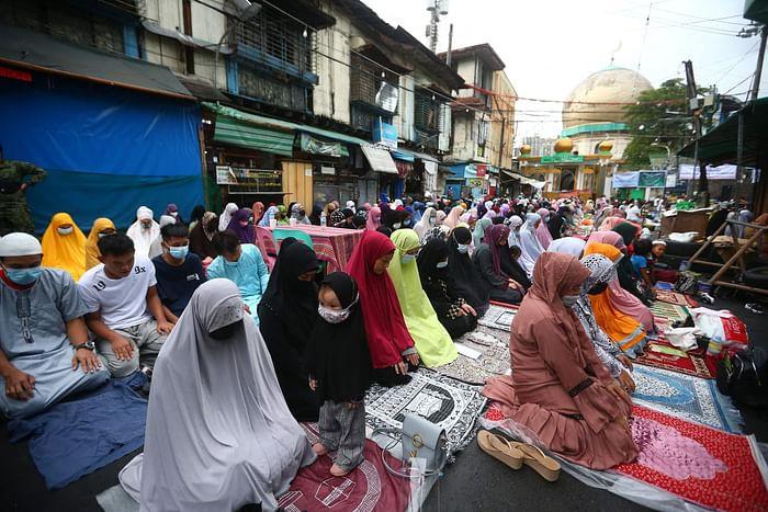Filipino Muslims offer prayers to mark Eidul Azha outside a mosque in Manila City, suburban Manila on July 20, 2021. PHOTO: AFP