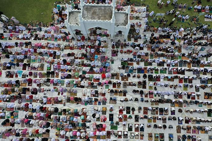 This aerial picture taken on July 20, 2021 shows Muslims attending prayers to mark the Eidul Azhar festival at the Baiturrahman Grand Mosque in Banda Aceh, Indonesia. PHOTO: AFP