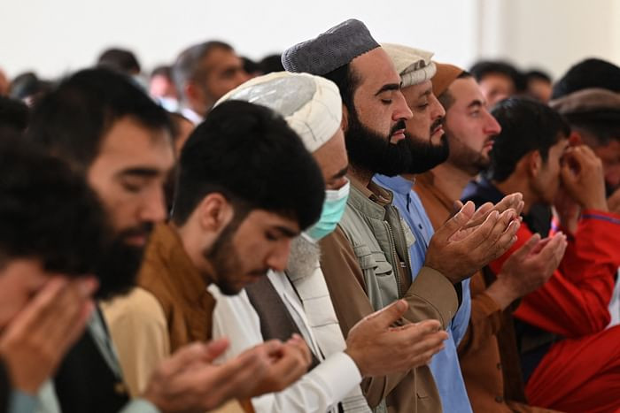 Afghan Muslim devotees offer their Eidul Azha prayers inside a mosque in Kabul on July 20, 2021. PHOTO: AFP