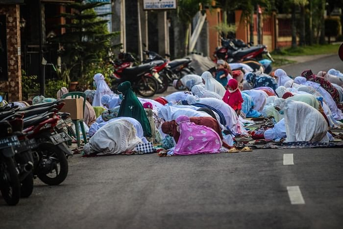 Muslims gather on the road to pray outside a mosque to mark Eidul Azha, the annual celebration known as the Festival of Sacrifice, in Ungaran, Central Java on July 20, 2021. PHOTO: AFP