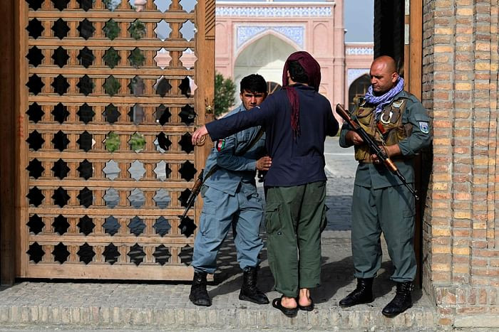 An Afghan security personnel frisks a devotee at the entrance of a mosque during the Eidul Azha prayers in Kabul on July 20, 2021. PHOTO: AFP