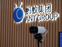 a thermal imaging camera is seen in front of a logo of ant group at the headquarters of ant group an affiliate of alibaba in hangzhou zhejiang province china october 29 2020 photo reuters