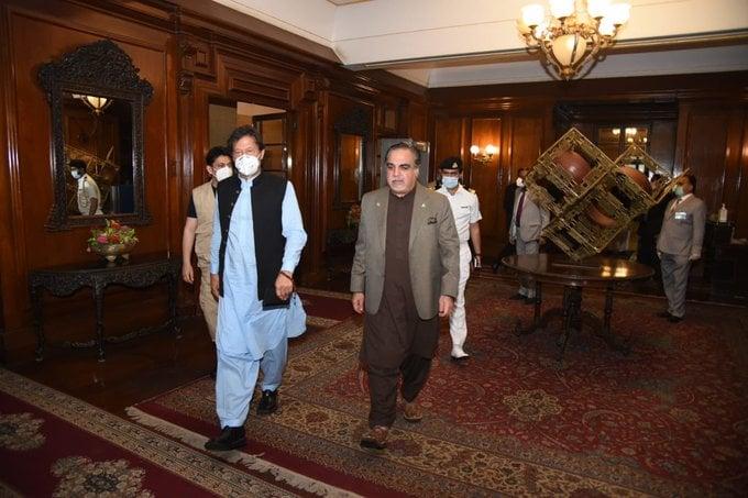 PM Imran Khan walks with Sindh Governor Imran Ismail. PHOTO: PTI