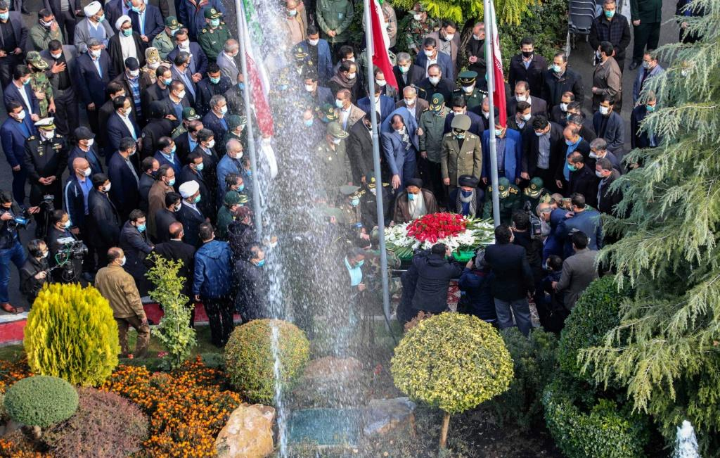 Iranian officials pray over the coffin of top nuclear scientist Mohsen Fakhrizadeh during his funeral in Tehran on Monday, in this picture provided by the country's defence ministry Photo: IRANIAN DEFENCE MINISTRY