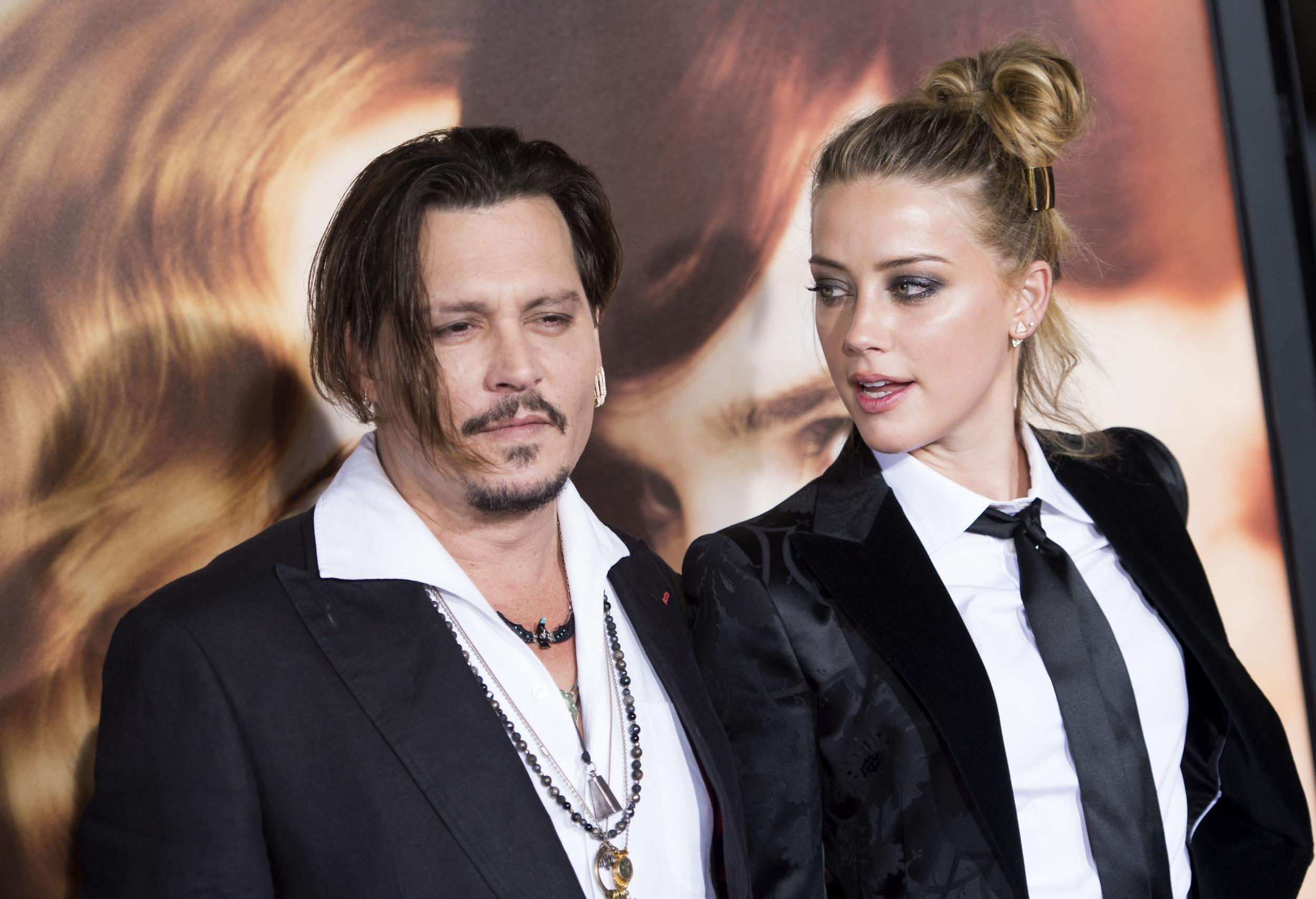 johnny depp was victim of abuser amber heard lawyers say