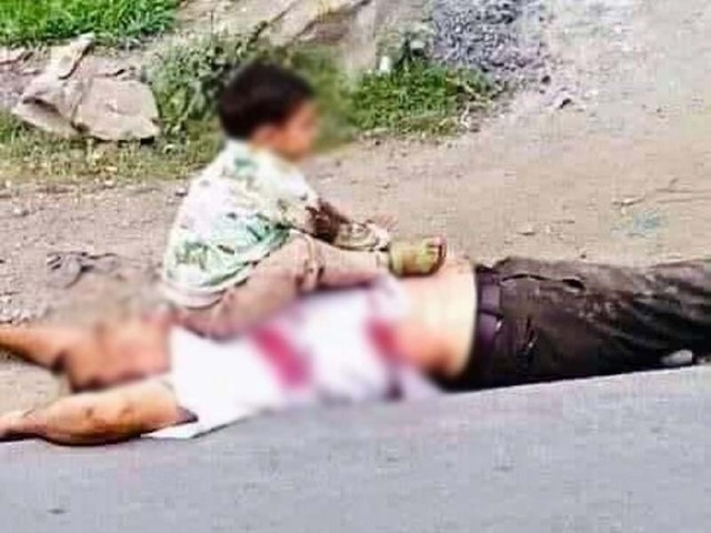 The heartbreaking photo of the child sitting on the body of his dead grandfather was widely shared on social media. PHOTO: COURTESY/HINDUSTAN TIMES
