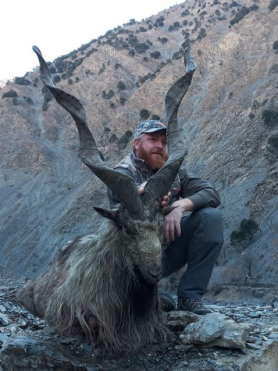 american huntner edward joseph poses with the longest horned markhor he hunted down in the toshi shasha conservation area in chitral photo express
