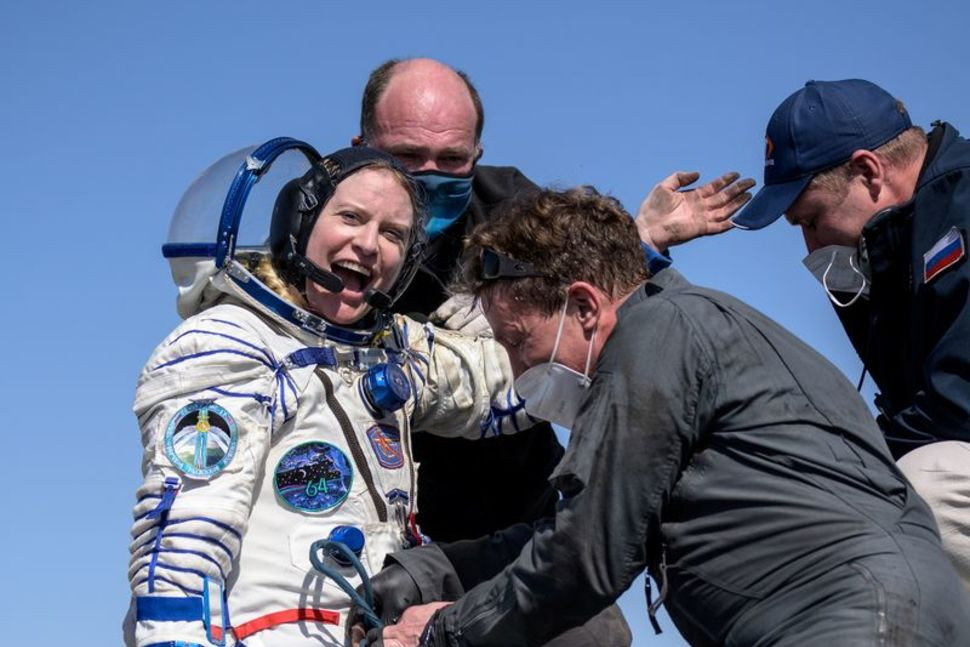 the international space station iss crew member kathleen rubins of nasa reacts shortly after the landing of the soyuz ms 17 space capsule in a remote area outside zhezkazgan kazakhstan april 17 2021 photo reuters