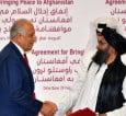 zalmay-khalilzad-and-mullah-abdul-ghani-baradar-shake-hands-photo-afp