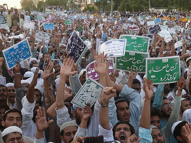 sunni muslim demonstrators shout slogans during an anti shia protest in karachi photo afp