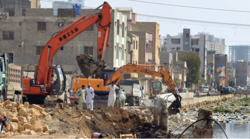 demolition drive officials use heavy machinery to clean and extend the qayyumabad drain ahead of next monsoon season photo express