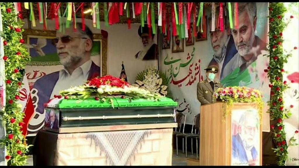 Mohsen Fakhrizadeh's coffin, draped in the Iranian flag and with a photo of the assassinated nuclear scientist Photo: IRANIAN DEFENCE MINISTRY
