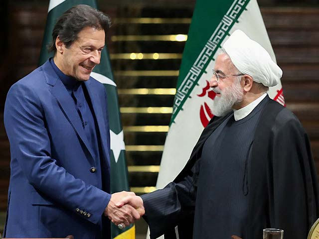 hassan rouhani shakes hands with imran khan photo afp